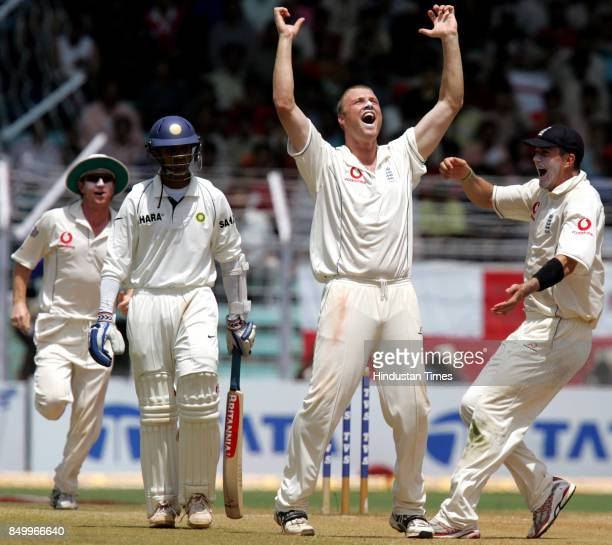 England captain Andrew Flintoff celebrates after taking the wicket of his Indian counterpart Rahul Dravid on the final day of the third Test at...