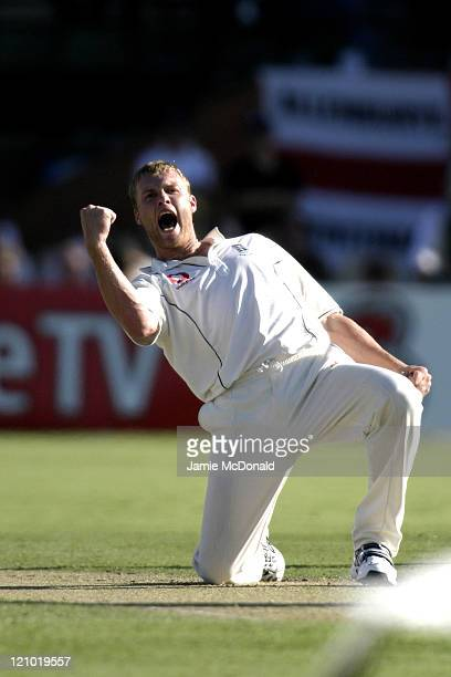 England Captain Andrew Flintoff celebrates the dismissal of Australian Justin Langer in Day Two of the Second Ashes Test at the Adelaide Oval...