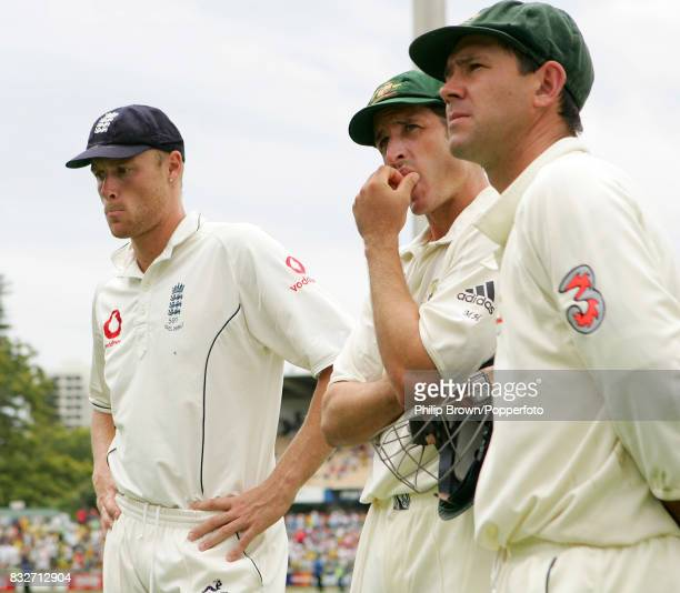 England captain Andrew Flintoff waiting for the presentation ceremony with Australia's Michael Hussey and Ricky Ponting after Australia won the 3rd...