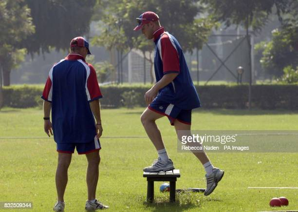 England captain Andrew Flintoff with physiotherapist Kirk Russell during a practice session at the Siri Fort Sports Complex Delhi India