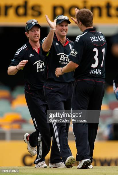 England captain Andrew Strauss celebrates catching out Australian captain Michael Clarke with Chris Woakes and Paul Collingwood during the Fifth One...