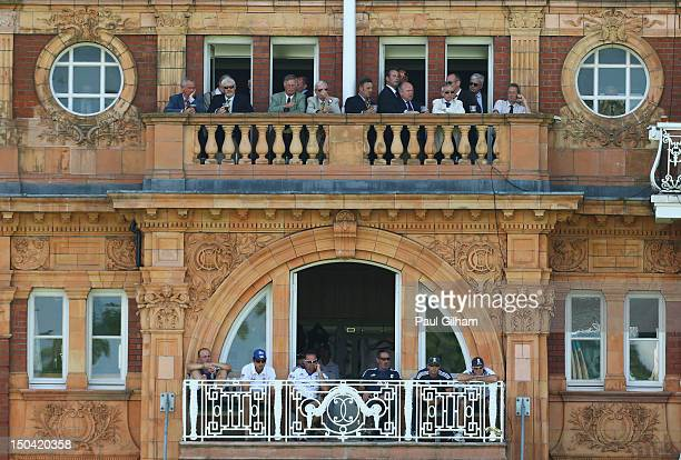 England Captain Andrew Strauss coach Andy Flower Jonathan Trott and Alastair Cook look on from the team balcony as Ian Bell and Jonny Bairstow of...