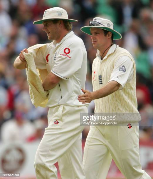 England captain Andrew Strauss encourages bowler Matthew Hoggard after Monty Panesar had dropped a chance off Pakistan's Mohammad Hafeez during the...