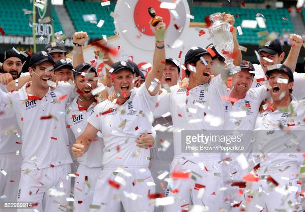 England captain Andrew Strauss holds up a replica of the Ashes urn at the Sydney Cricket Ground after England won the 5th Test match between...