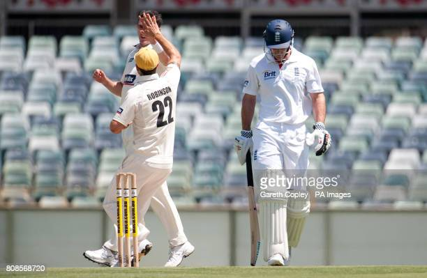 England captain Andrew Strauss leaves the field after being dismissed by Western Australia's Steve MaGoffin uring the tour match at the WACA Perth
