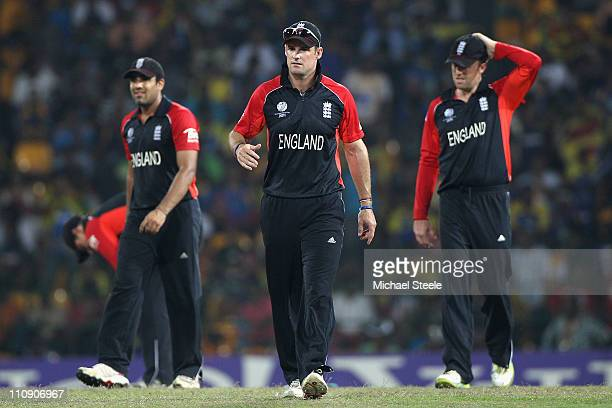 England captain Andrew Strauss Ravi Bopara and Graeme Swann during the 2011 ICC World Cup QuarterFinal match between Sri Lanka and England at R...