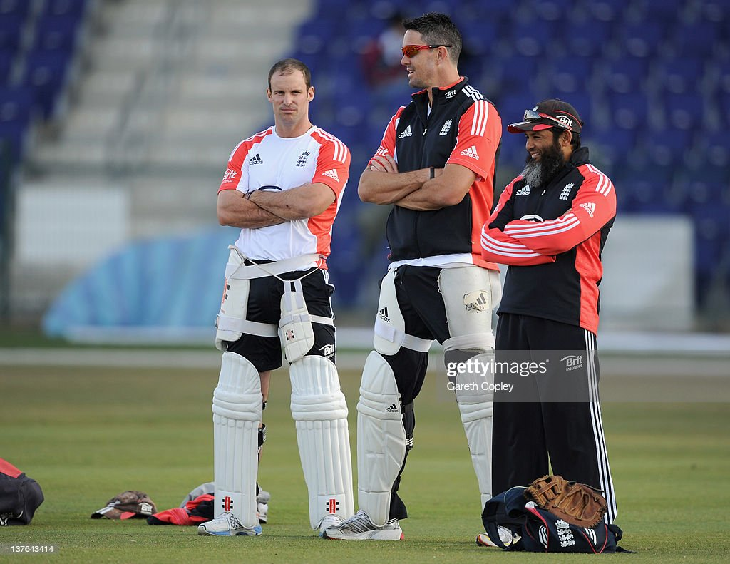 England captain Andrew Strauss speaks with Kevin Pietersen and spin bowling coach Mushtaq Ahmed during a nets session at Sheikh Zayed Stadium on...