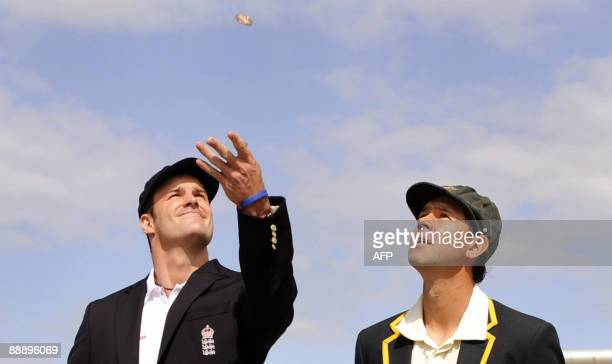 England captain Andrew Strauss tosses the coin with his Australian counterpart Ricky Ponting on the first day of the first Ashes Test match in...