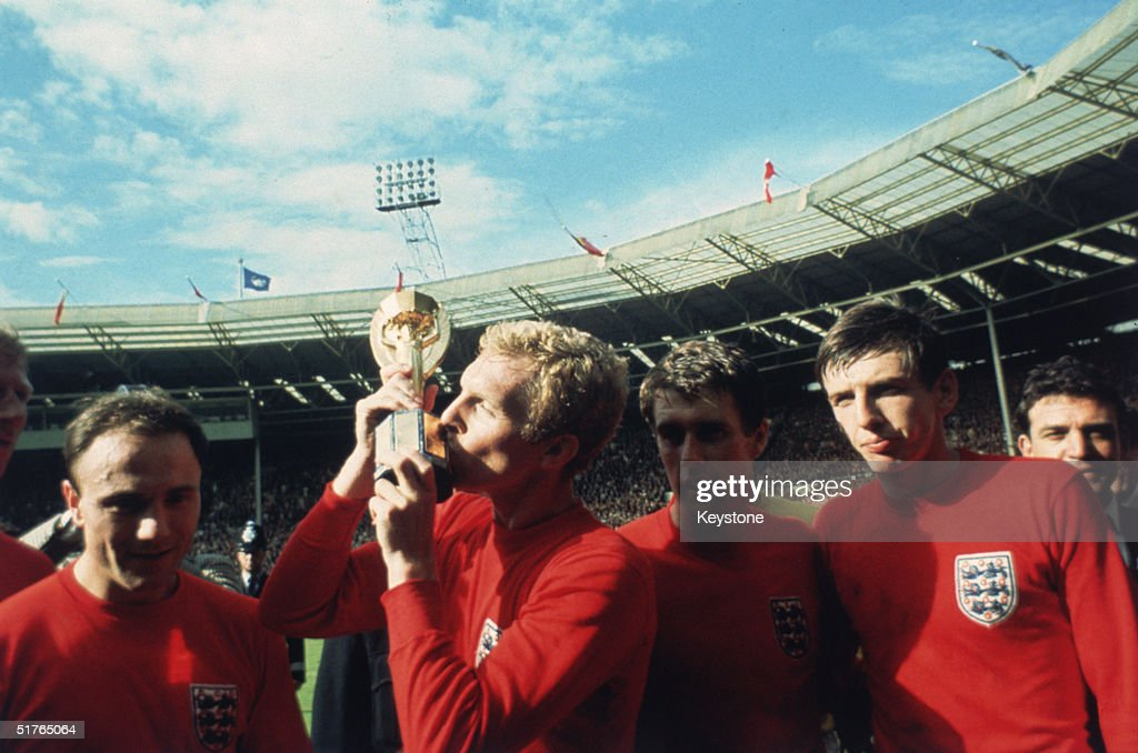 England captain <a gi-track='captionPersonalityLinkClicked' href=/galleries/search?phrase=Bobby+Moore&family=editorial&specificpeople=206646 ng-click='$event.stopPropagation()'>Bobby Moore</a> kissing the Jules Rimet trophy as the team celebrate winning the 1966 World Cup final against Germany at Wembley Stadium. His team mates are, left to right, George Cohen, <a gi-track='captionPersonalityLinkClicked' href=/galleries/search?phrase=Geoff+Hurst&family=editorial&specificpeople=206880 ng-click='$event.stopPropagation()'>Geoff Hurst</a> and <a gi-track='captionPersonalityLinkClicked' href=/galleries/search?phrase=Martin+Peters&family=editorial&specificpeople=643328 ng-click='$event.stopPropagation()'>Martin Peters</a>, 30th July 1966.