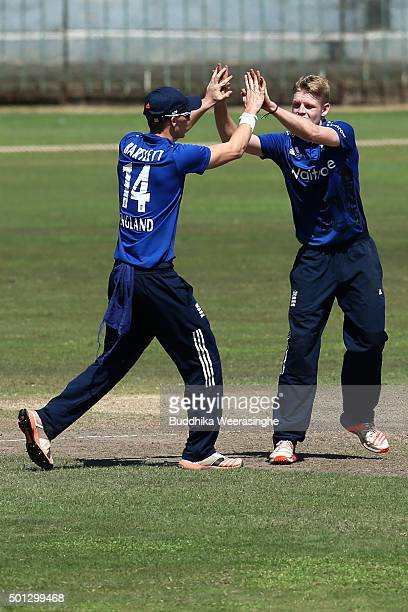 England captain Brad Taylor celebrates with his team mate taking the wicket of Wanidu Hasaranga of Sri Lanka during the Under 19 International...