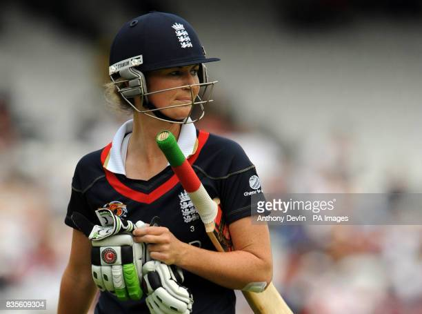 England captain Charlotte Edwards leaves the field after being bowled out by New Zealand's Sian Ruck during the Final of the Women's ICC World...