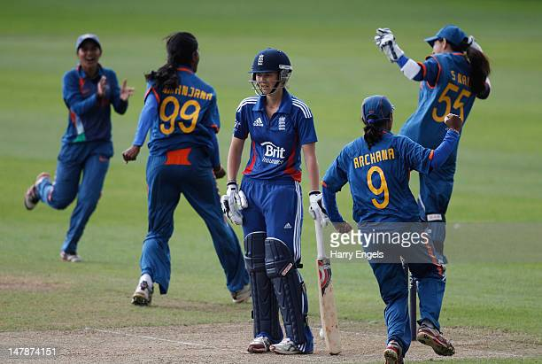 England captain Charlotte Edwards looks on in despair after being dimissed as the Indian players celebrate during the 3rd NatWest International One...
