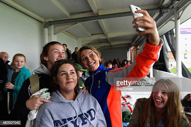 England captain Charlotte Edwards poses for selfies with fans as Wet weather delays the start of the 3rd Royal London ODI of the Women's Ashes Series...