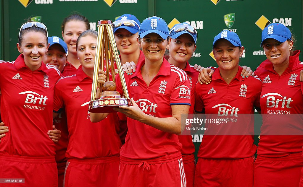 England captain <a gi-track='captionPersonalityLinkClicked' href=/galleries/search?phrase=Charlotte+Edwards&family=editorial&specificpeople=618915 ng-click='$event.stopPropagation()'>Charlotte Edwards</a> poses with the team and the trophy after game three of the Women's International Twenty20 series between Australia and England on February 2, 2014 in Sydney, Australia.