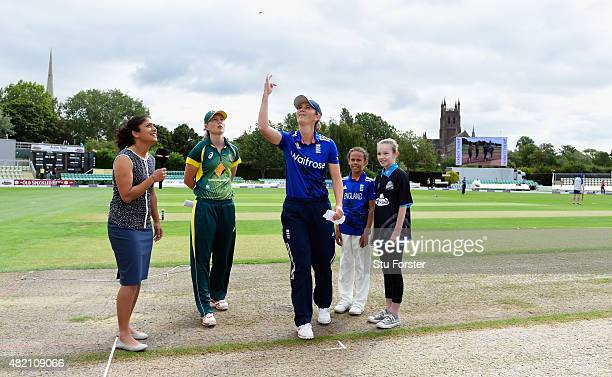 England captain Charlotte Edwards tosses the coin watched by Australia captain Meg Lanning before the 3rd Royal London ODI of the Women's Ashes...