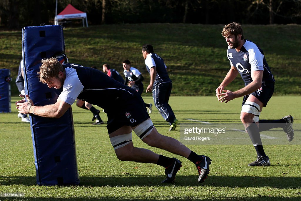 England captain <a gi-track='captionPersonalityLinkClicked' href=/galleries/search?phrase=Chris+Robshaw&family=editorial&specificpeople=2375303 ng-click='$event.stopPropagation()'>Chris Robshaw</a> and Geoff Parling run through tackling drills during the England training session at Pennyhill Park on November 29, 2012 in Bagshot, England.