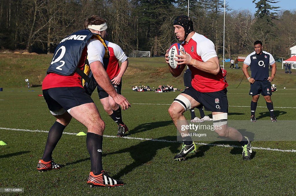 England captain, Chris Robshaw charges with the ball during the England training session held at Pennyhill Park on February 19, 2013 in Bagshot, England.