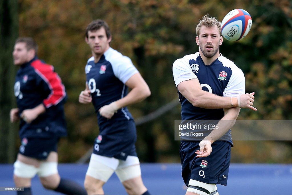 England captain <a gi-track='captionPersonalityLinkClicked' href=/galleries/search?phrase=Chris+Robshaw&family=editorial&specificpeople=2375303 ng-click='$event.stopPropagation()'>Chris Robshaw</a> (R) runs through drills with teammatesduring the England training session at Pennyhill Park on November 22, 2012 in Bagshot, England.