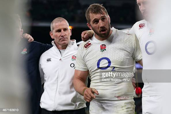 England captain Chris Robshaw speaks to his team as head coach Stuart Lancaster looks on at the end of the RBS Six Nations match between England and...