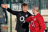 England captain Chris Robshaw speaks with head coach Stuart Lancaster during the England training session at Surrey Sports Park on February 2 2012 in...