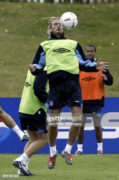 England captain David Beckham controls the ball on his chest during the warmup for training at The Cliff training ground Manchester prior to...