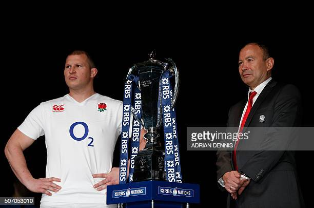 England captain Dylan Hartley and coach Eddie Jones pose for a photograph with the trophy during the official launch of the 2016 Six Nations...