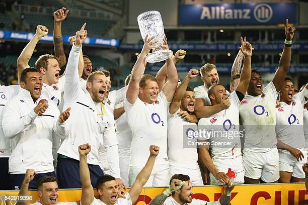 England captain Dylan Hartley poses with the Cook Cup and team mates after winning the International Test match between the Australian Wallabies and...