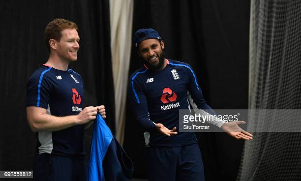 England captain Eoin Morgan and Adil Rashid share a joke during a game of Football during nets at the Swalec Stadium ahead of the ICC Champions...