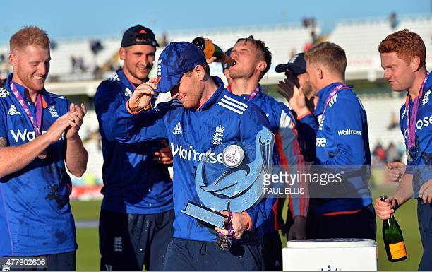 England captain Eoin Morgan and team celebrate with the series trophy after the fifth one day international cricket match between England and New...