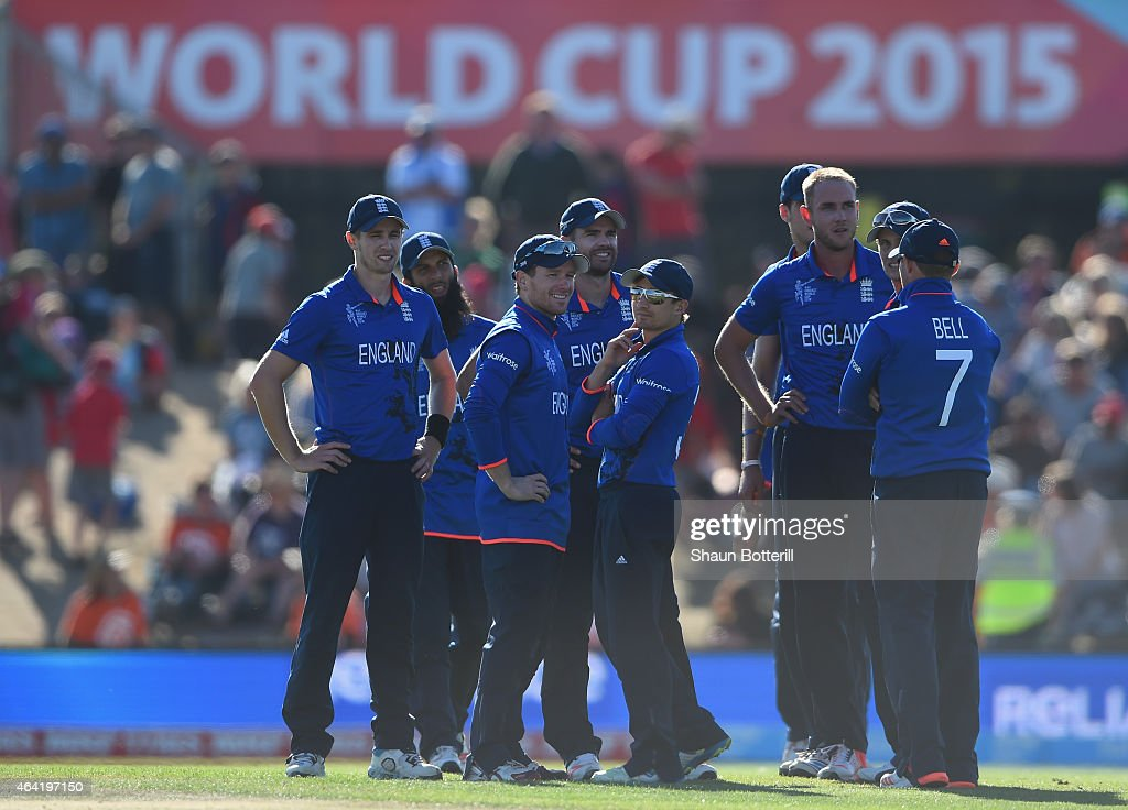 England captain Eoin Morgan and teammates await the umpire's decision during the 2015 ICC Cricket World Cup match between England and Scotland at...