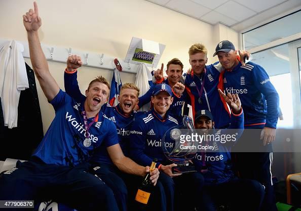 England captain Eoin Morgan celebrates in the dressing room with teammates David Willey Sam Billings James Taylor Jason Roy Adil Rashid and Jos...