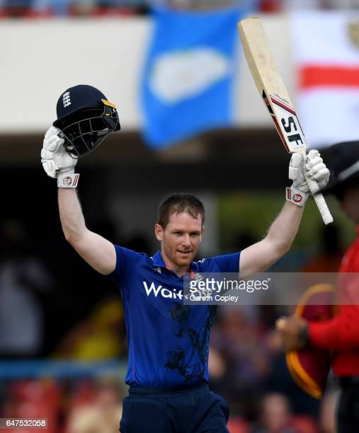 England captain Eoin Morgan celebrates reaching his century during the first One Day International between the West Indies and England at Sir Vivian...