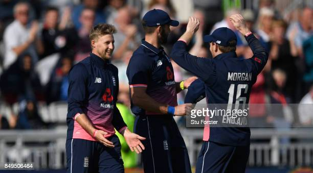 England captain Eoin Morgan congratulates Joe Root after he had caught Chris Gayle during the 1st Royal London One Day International match between...