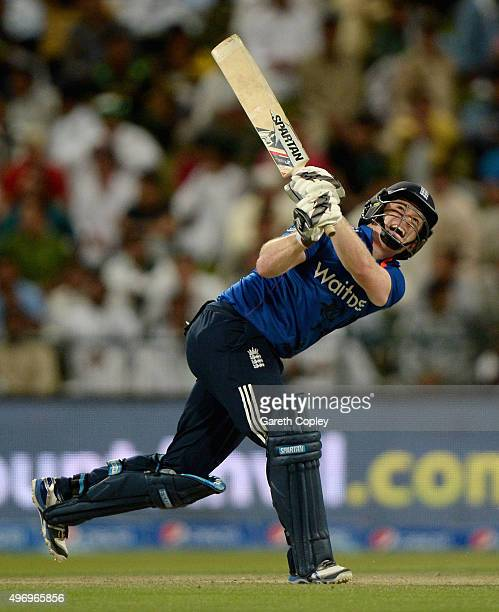 England captain Eoin Morgan hits out for six runs during the 2nd One Day International between Pakistan and England at Zayed Cricket Stadium on...