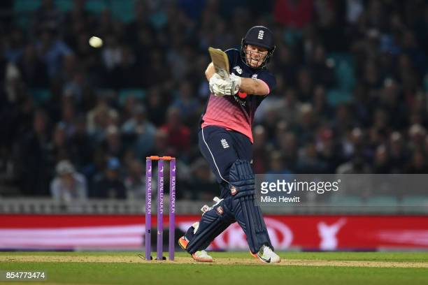 England captain Eoin Morgan hits the ball straight to substitute fielder Kyle Hope during the 4th Royal London One Day International between England...