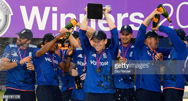 England captain Eoin Morgan lifts the series trophy after their 41 victory after the 5th One Day International between England and Pakistan at Swalec...