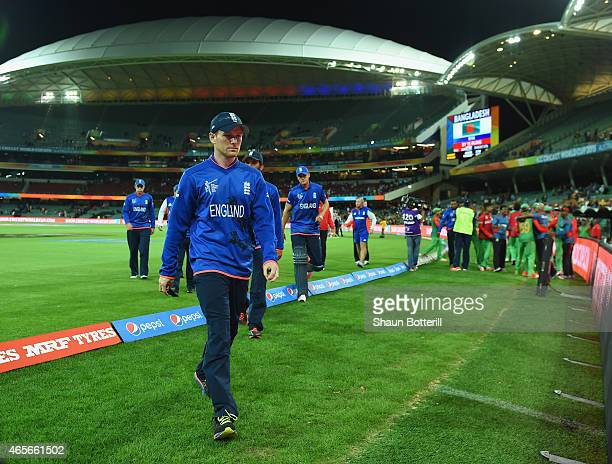 England captain Eoin Morgan looks dejected as he leaves the field after the 2015 ICC Cricket World Cup match between England and Bangladesh at...