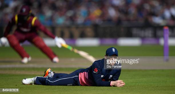 England captain Eoin Morgan looks on after a shot from West Indies batsman Evin Lewis evades him during the 1st Royal London One Day International...