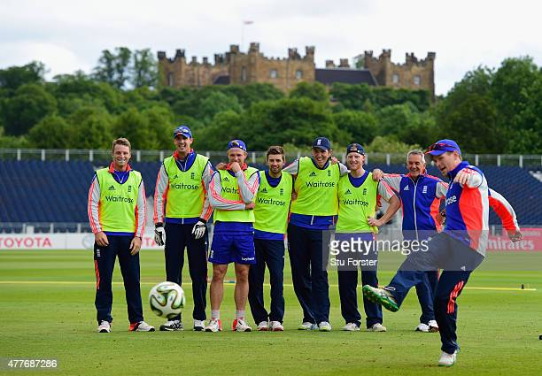 England captain Eoin Morgan takes a penalty in a football penalty shootout watched by team mates in the shadow of Lumley Castle during England net...