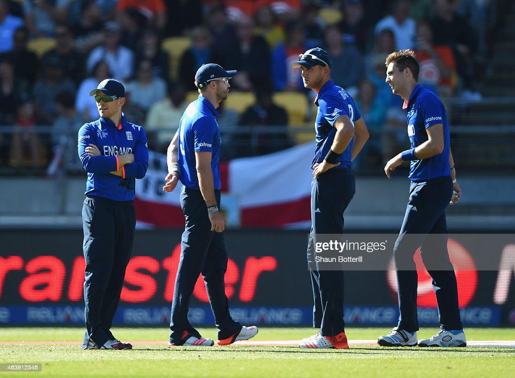 England captain <a gi-track='captionPersonalityLinkClicked' href=/galleries/search?phrase=Eoin+Morgan&family=editorial&specificpeople=689581 ng-click='$event.stopPropagation()'>Eoin Morgan</a> talks with bowlers <a gi-track='captionPersonalityLinkClicked' href=/galleries/search?phrase=James+Anderson+-+Cricket+Player&family=editorial&specificpeople=6920305 ng-click='$event.stopPropagation()'>James Anderson</a>, <a gi-track='captionPersonalityLinkClicked' href=/galleries/search?phrase=Steven+Finn+-+Cricketer&family=editorial&specificpeople=7843917 ng-click='$event.stopPropagation()'>Steven Finn</a> and <a gi-track='captionPersonalityLinkClicked' href=/galleries/search?phrase=Stuart+Broad&family=editorial&specificpeople=574360 ng-click='$event.stopPropagation()'>Stuart Broad</a> during the 2015 ICC Cricket World Cup match between England and New Zealand at Wellington Regional Stadium on February 20, 2015 in Wellington, New Zealand.