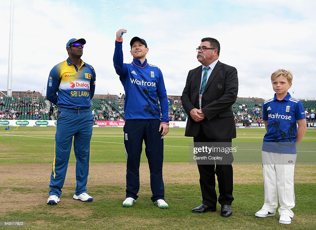 England captain <a gi-track='captionPersonalityLinkClicked' href=/galleries/search?phrase=Eoin+Morgan&family=editorial&specificpeople=689581 ng-click='$event.stopPropagation()'>Eoin Morgan</a> tosses the coin alongside <a gi-track='captionPersonalityLinkClicked' href=/galleries/search?phrase=Angelo+Mathews&family=editorial&specificpeople=5622021 ng-click='$event.stopPropagation()'>Angelo Mathews</a> of Sri Lanka ahead of the 3rd ODI Royal London One Day International match between England and Sri Lanka at The County Ground on June 26, 2016 in Bristol, England.