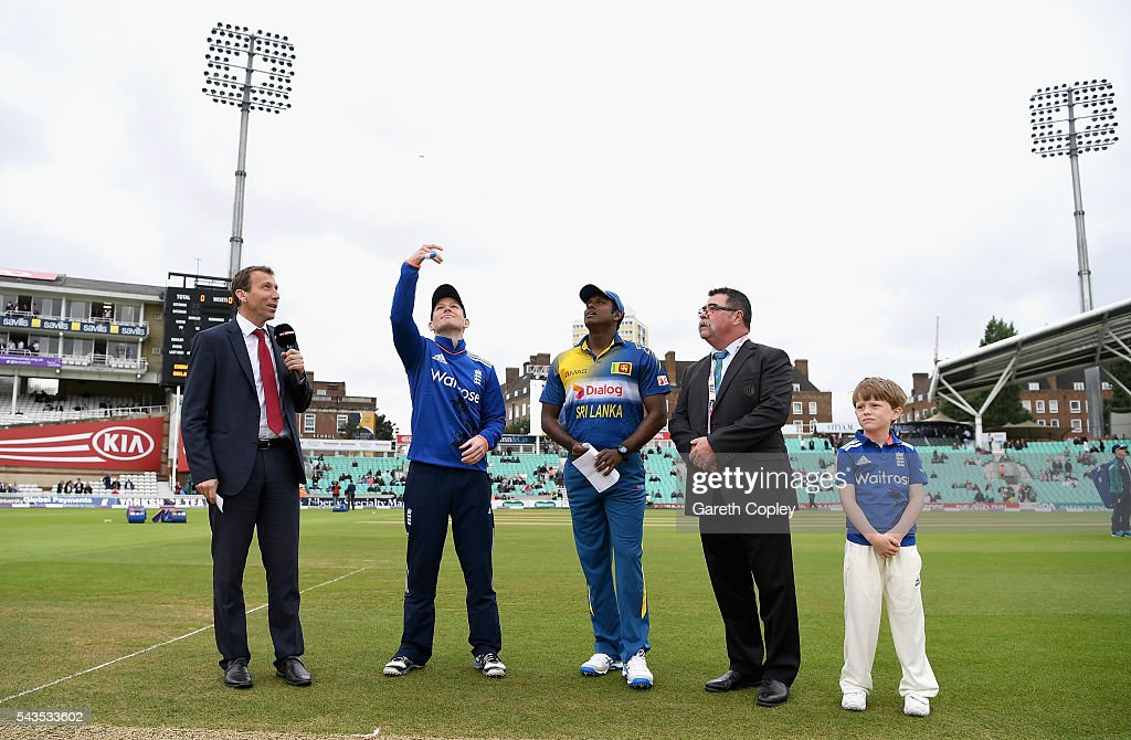 England captain <a gi-track='captionPersonalityLinkClicked' href=/galleries/search?phrase=Eoin+Morgan&family=editorial&specificpeople=689581 ng-click='$event.stopPropagation()'>Eoin Morgan</a> tosses the coin alongside <a gi-track='captionPersonalityLinkClicked' href=/galleries/search?phrase=Angelo+Mathews&family=editorial&specificpeople=5622021 ng-click='$event.stopPropagation()'>Angelo Mathews</a> of Sri Lanka during the 4th ODI Royal London One Day International match between England and Sri Lanka at The Kia Oval on June 29, 2016 in London, England.