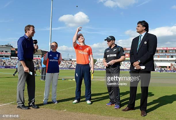 England captain Eoin Morgan tosses the coin alongside Brendon McCullum of New Zealand ahead of the NatWest International Twenty20 match between...