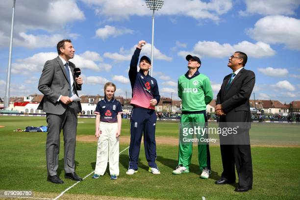 England captain Eoin Morgan tosses the coin alongside Ireland captain William Porterfield ahead of the Royal London One Day International between...