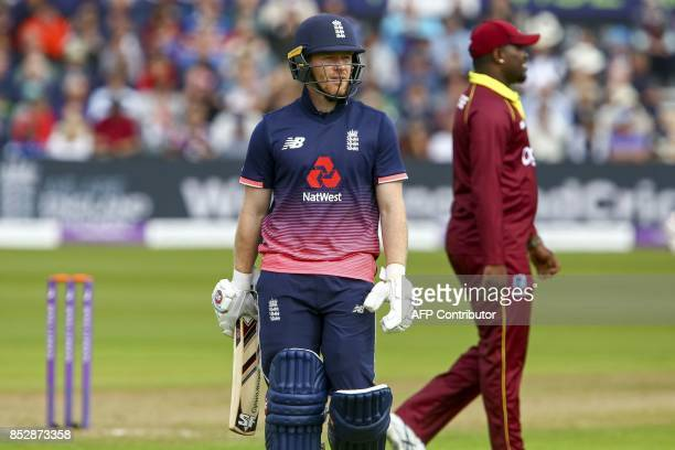 England captain Eoin Morgan walks back to the pavilion after losing his wicket first ball during the third one day international cricket match played...