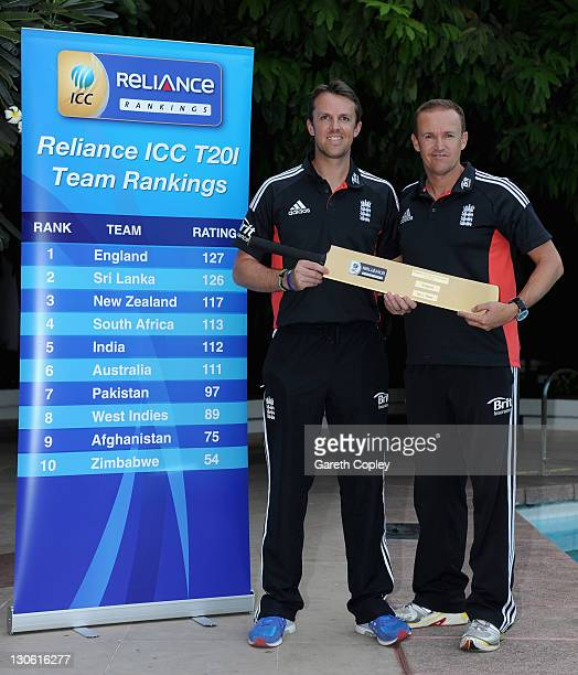 England captain Graeme Swann and coach Andy Flower are presented with a gold bat after been announced as the number one in the new ICC 20Twenty team...