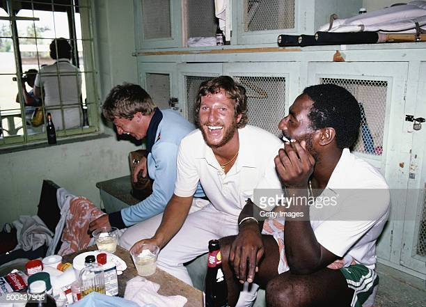 England captain Ian Botham and Graham Stevenson share a joke with Viv Richards in the dressing room after the 3rd Test match between England and West...