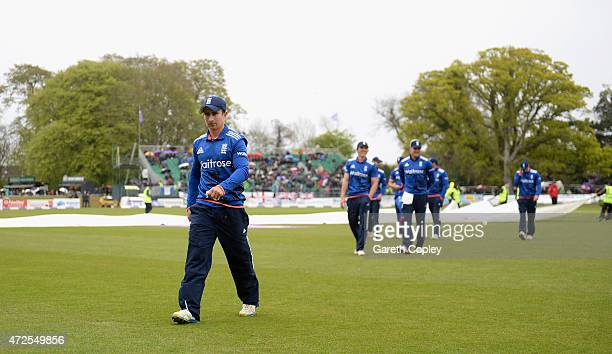 England captain James Taylor leaves the field as rain stops play during the Royal London One Day International between Ireland and England at...