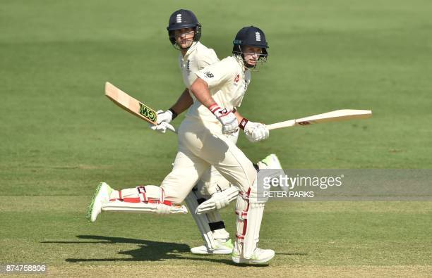 TOPSHOT England captain Joe Root and Dawid Malan run between the wickets on the second day of a fourday Ashes tour match against Cricket Australia XI...