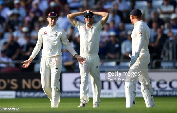 England captain Joe Root asks for a umpire review alongside Alastair Cook and Jonathan Bairstow during day two of the 2nd Investec Test between...